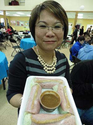 Hang Nguyen offers salad rolls