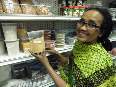 Tsige Meshesha shows off spices and other ingredients for sale at Nile Grocery.