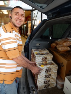 Delivery man Jose Eric Flores loads the van.