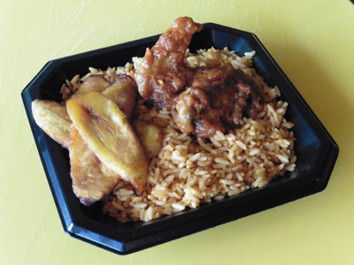 "Jollof Rice with fried plantains, chicken and ""stew."""