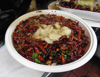 Szechuan Spicy Fish Filet bowl brims with red peppers.