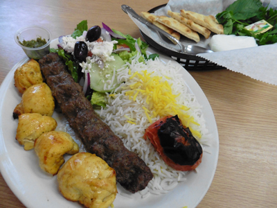 Plate with Koobideh and Joojeh kabobs, roasted over open coals.