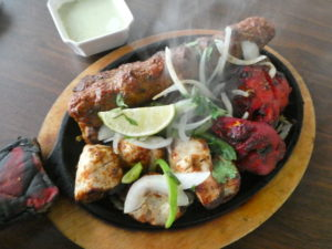 Mixed grill, the signature dish at Zafran, offers an array of meats barbecued Pakistani-style.