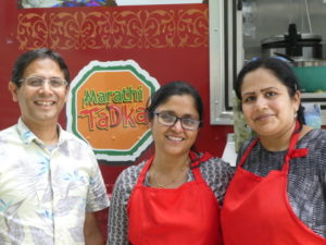 Sandeep Padhye (left) and wife Aparna Padhye (center) with teammate Amruta Deshpande.