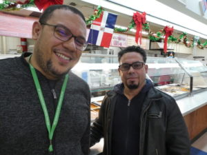"Federico Rios (left) with Ramon Antonio ""Tony"" Tejada at Tony's Deli inside Compare grocery on Milton Road."