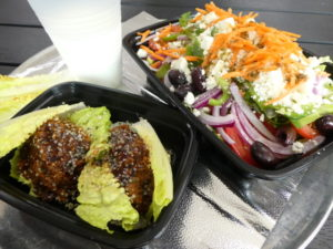 Wrapway looks to build fans among Charlotte's vegetarians and vegans with its grainburger (Turkish kofta, left), Greek Village salad (right), and a traditional yogurt drink called ayran.