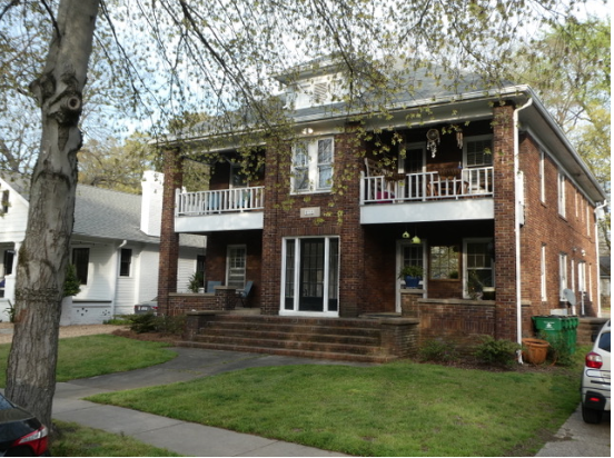 "These 4-unit dwellings, 2 up and 2 down with individual front porches, are common in the streetcar suburbs of Charlotte and surrounding cities. The ""quadraplex"" is part of our characteristic architecture -- just as the ""triple decker"" apartment is characteristic in New England. This one went up in 1928, high point of Charlotte's pre-Depression ""housing bubble."" First tenants included George Avant, engineer at the massive Ford plant on Statesville Avenue that assembled Model A automobiles (now CAMP North End)."