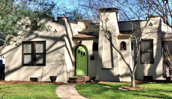 "Rare around here but common in the southwestern U.S., the flat roof, stucco walls and arches recall the Spanish adobe haciendas of Mexican-era California. ""My Adobe Hacienda"" became a popular love song on the new-fangled radio shortly after this house was built in the late 1920s."