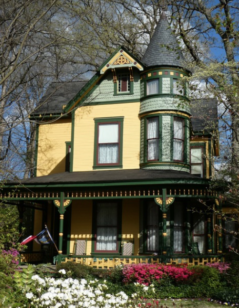One of the most-photographed Victorian Era houses in the Southeast, thanks to loving restoration by Fran and Bill Gay, who began in 1973 when this was a run-down rooming house. It started life in the 1890s on North Tryon Street, one of two identical houses built for the sons of merchant R.M. Miller. In 1915 mule teams pulled it out here to Charlotte's fashionable new suburb.