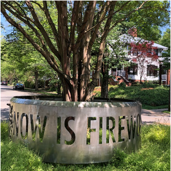 Amy Bagwell, poetry professor at Central Piedmont Community College, and artist Graham Carew created this sculpture in 2016, part of the Wall Poems series throughout the city supported by the Arts