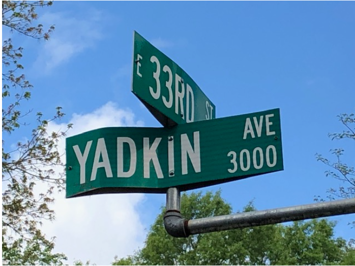 The street name honors the Yadkin River, which had powered one of the South's earlier experiments with electricity, the 1898 Idols dam that supplied current to mills around Winston-Salem. It's one of several textile-inspired street names in NoDa, including Warp and Card (two textile processes) and Charles, Holt and Spencer (for mill owners Charles Worth Johnston, William Holt and Jesse Spencer)