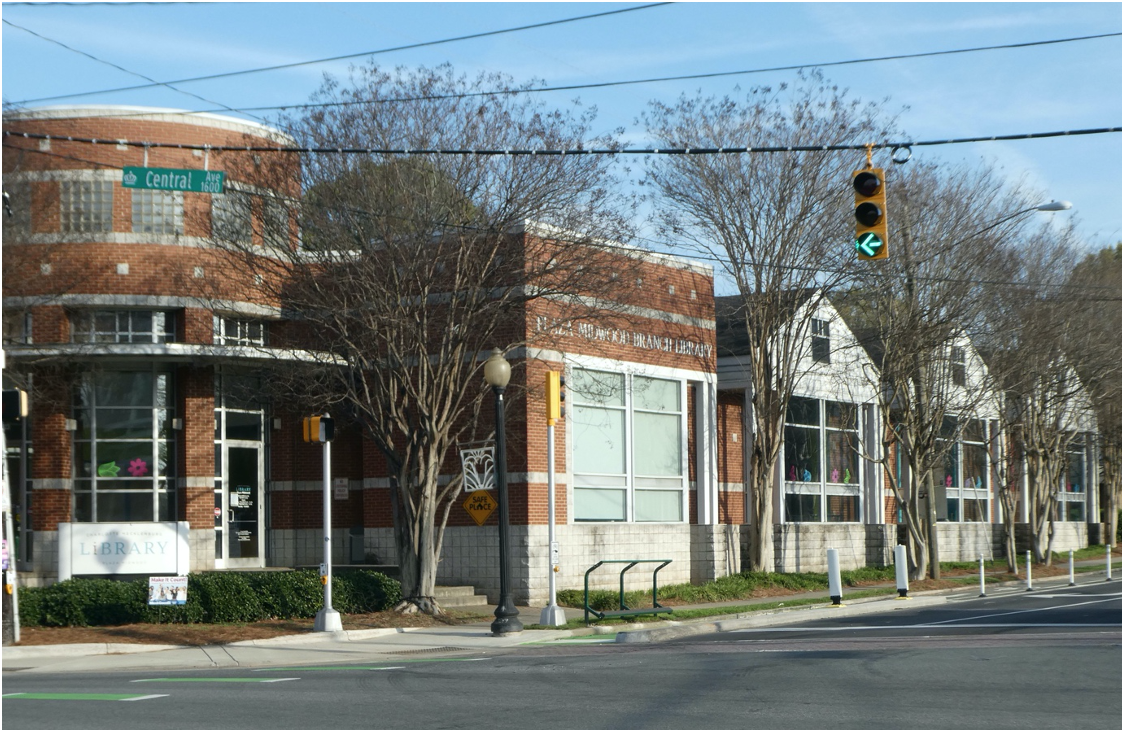 Architecturally, this is one of Mecklenburg County's most delightful branch libraries. The main brick section honors the corner, while the rear portion has wood siding and gable roofs to blend with the houses of The Plaza. Charlotte architect Pat Campbell of LS3P Associates designed it in 1996.