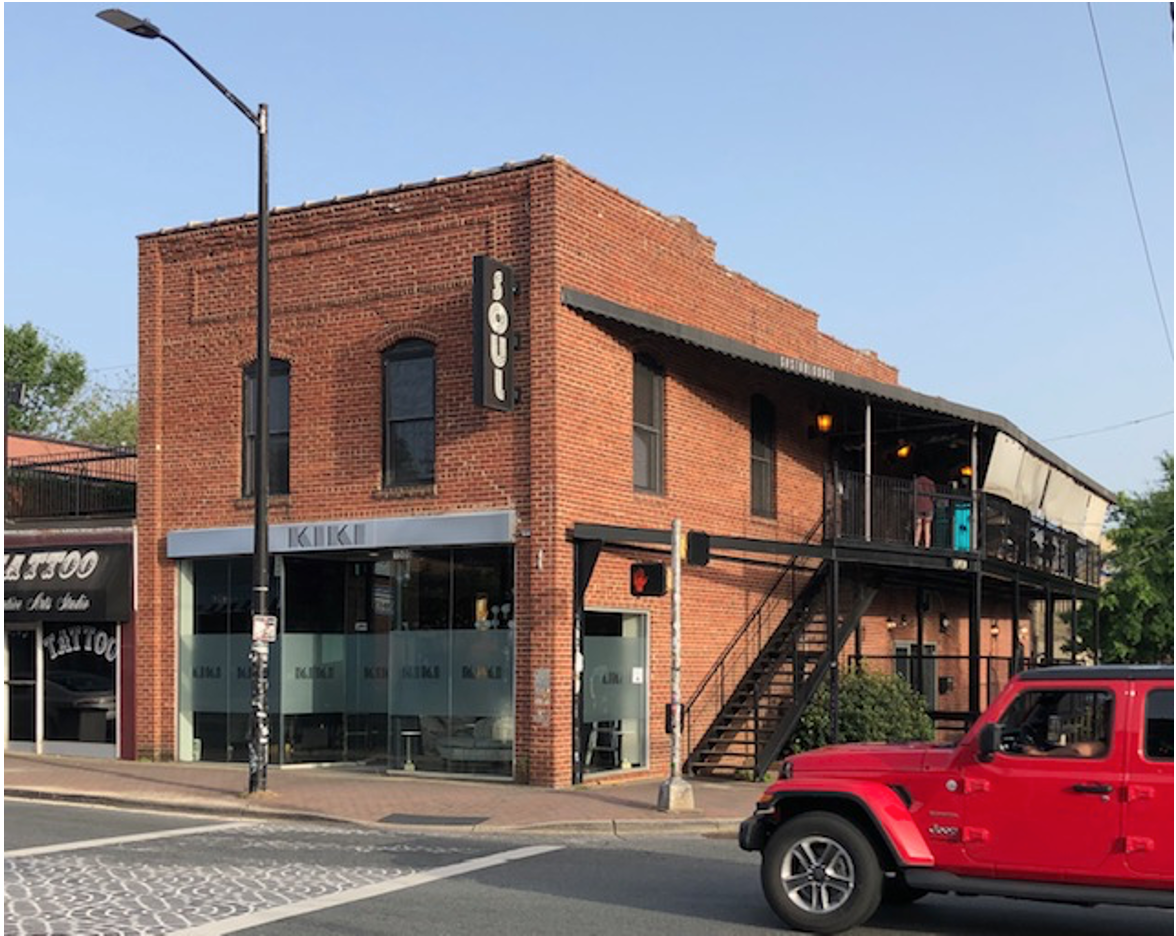 This two-story brick store was likely the first structure to spring up in this commercial strip. City Directories show it as Lewis Long's Grocery in 1916. In 2009 hip DJ/entrepreneur Andy Kastanas added the balcony and opened Soul upstairs. Lesa Kastanas led the most recent renovation in 2019: Kiki eatery and Tattoo lounge downstairs.