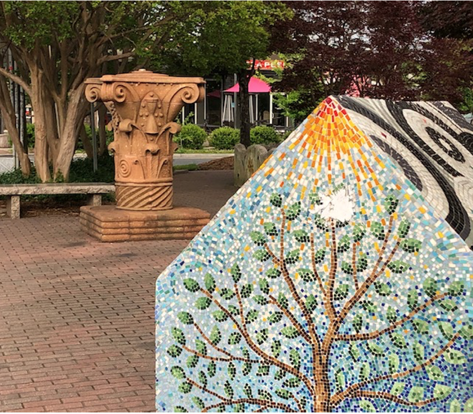 Sculptures by Paul Sires (the carved terra cotta piece that looks like the capital of a Corinthian column) and Ruth Ava Lyons (the mosaic walls and 'house') made this spot a point of pride in 1994 – a key step in the rebirth of this then-neglected business district. Sires and Lyons ran Center of the Earth gallery on North Davidson Street in those years, which sparked the revitalization of Charlotte's NoDa neighborhood.