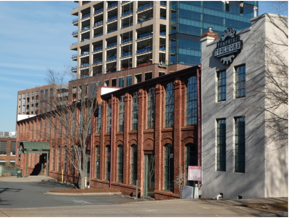 Look across the street to see another D.A. Tompkins building. He had this foundry and machine works built beginning in 1902 to produce and repair specialized machinery for textile mills and cottonseed oil processing plants.