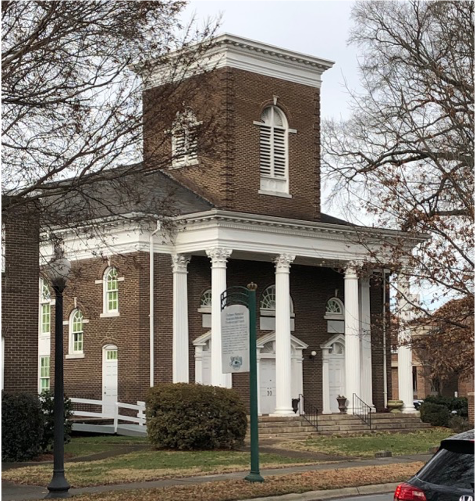 Now Grace Covenant, this building was dedicated in 1910 as Chalmers Memorial, a church in the Associated Reform Presbyterian denomination. Its most famous member was young Billy Graham, whose family farmed near what is now Park Road Shopping Center.