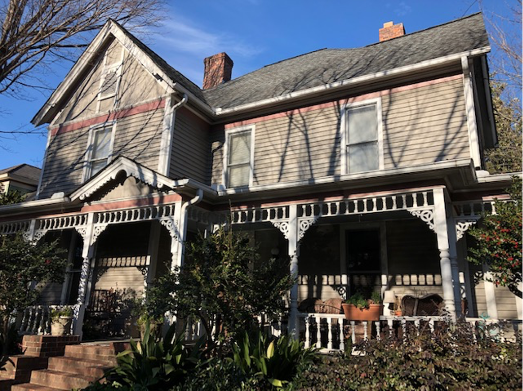 Another 1894 house, built soon after Dilworth began in 1891. J.A. Harrill commuted downtown daily on the streetcar to work as a clerk at A.H. Porter men's clothing and shoes. Like neighbor J.N. Mallonee, he tired of the commute by 1897 and moved into Fourth Ward. Shopkeeper Porter's son bought the house and evidently loved it; the Porter family lived here into the 1950s. Dig that porch – an outdoor living room!